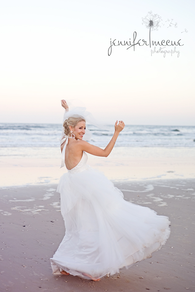 bride dancing on beach